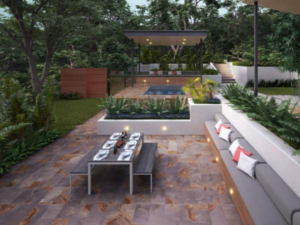 A patio or deck in your yard can add extra space to comfortably